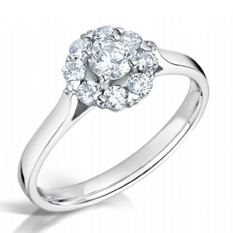 G VS Diamond cluster ring, Platinum. Round brilliant centre stone - 0.65ct